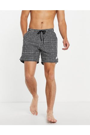 Nike City Edition woven shorts in and white check