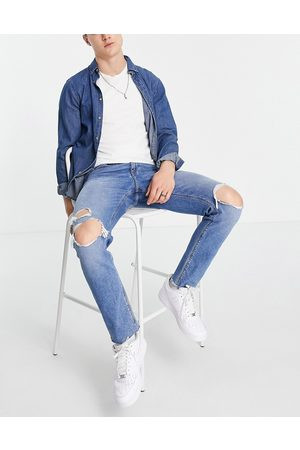 ASOS Slim jeans with knee rips and raw hem in mid wash
