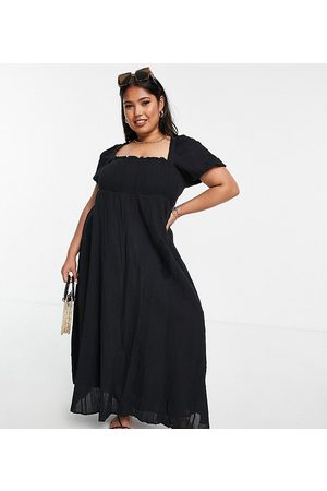ASOS ASOS DESIGN Curve shirred bustier maxi dress with puff sleeve in seersucker in