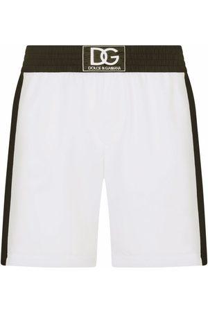 Dolce & Gabbana Men Swim Shorts - Logo-patch colour-block swim shorts