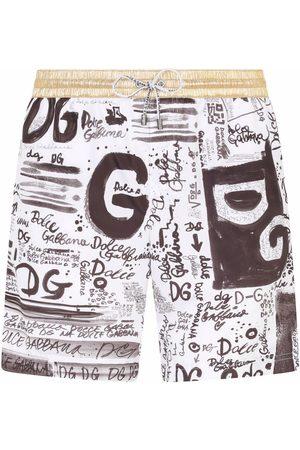 Dolce & Gabbana Men Swim Shorts - Doodle logo-print contrast-trim swim shorts