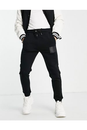 JAMESON CARTER Men Joggers - Leighton leather patch tapered joggers in
