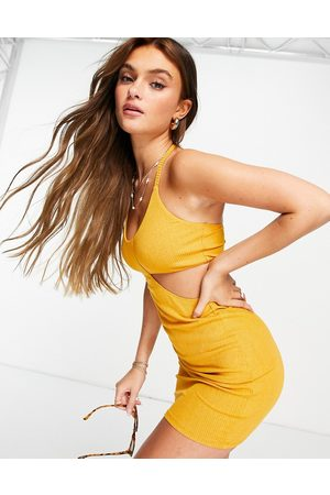 ASOS Cut out ribbed mini dress with tie neck in mustard