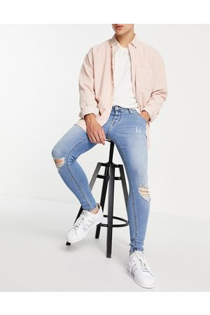 ASOS Men Skinny - Spray on jeans with power stretch in light wash with knee rips