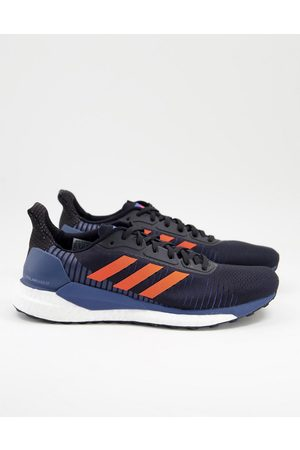 adidas Running Solar glide trainers and red