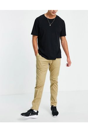Nike Men Chinos - Dri-FIT slim chino trousers in -Neutral