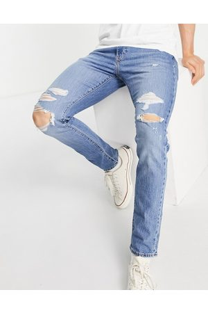 Levi's Men Slim - Levi's 512 slim tapered fit distressed jeans in mid wash