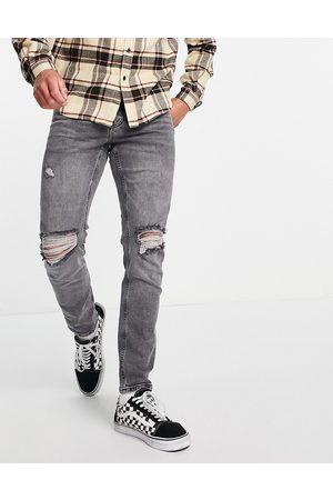 ASOS Stretch slim jeans in washed grey with knee rips
