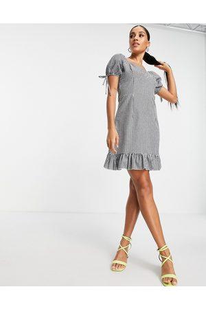 I Saw It First Puff sleeve mini dress with flippy hem in mono check-Multi