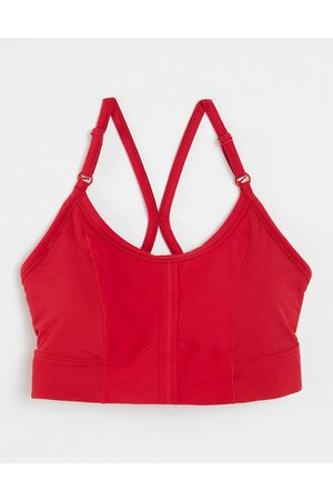 Nike Nike Yoga Indy light support strappy sports bra in