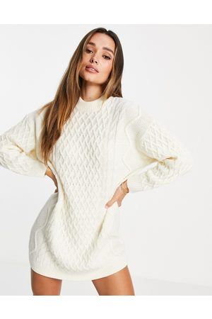ASOS DESIGN Knitted mini dress in cable knit in cream