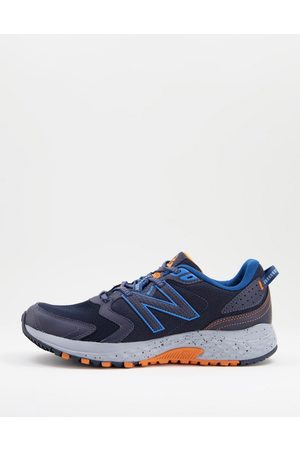 New Balance Trail 410 trainers in and grey
