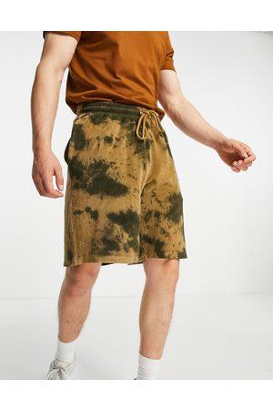 ASOS DESIGN Oversized towelling shorts in tie dye