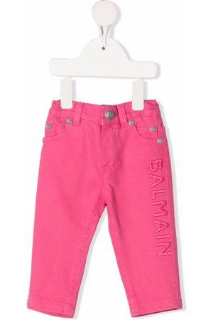 Balmain Embroidered-logo elasticated jeans