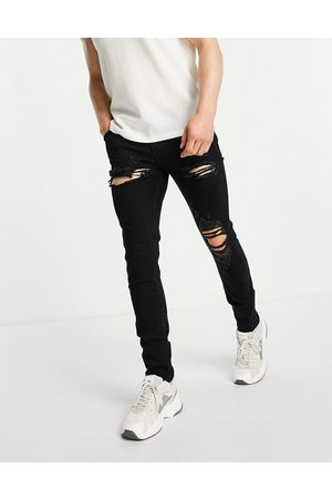ASOS DESIGN Skinny jeans in with heavy rips