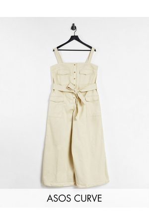 ASOS DESIGN Curve contrast stitch button front dungaree jumpsuit in stone-Neutral