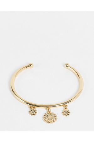 ASOS DESIGN Bangle bracelet with daisy charms in tone