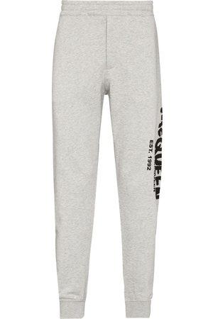 Alexander McQueen Men Pants - Graffiti-print track pants