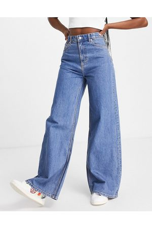 Weekday Ace organic cotton high waist wide leg jeans in mid wash 90's