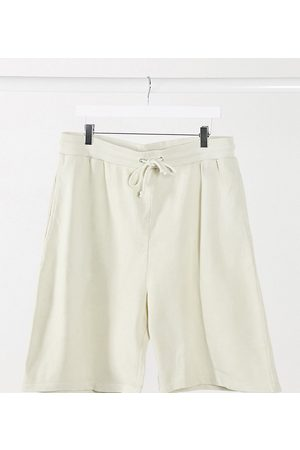 Collusion Unisex shorts in washed ivory
