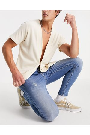 ASOS Spray on jeans with power stretch in mid wash with abrasions