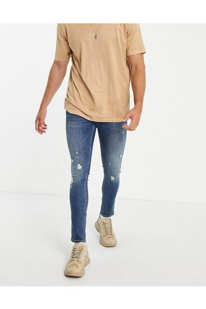ASOS Men Skinny - Organic cotton blend skinny jeans in tinted dark wash with rips and turn up