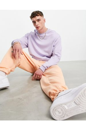 ASOS Men Sports Sweatshirts - Tracksuit with oversized hoodie and super oversized joggers in purple/orange-Multi
