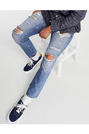 ASOS Men Slim - Slim jeans in mid wash with heavy rips