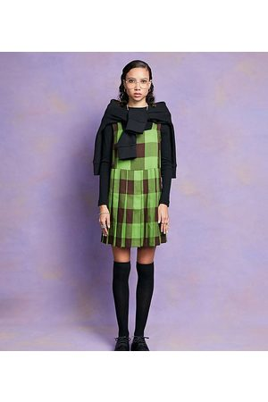 COLLUSION Pleated mini pinafore dress in and green check