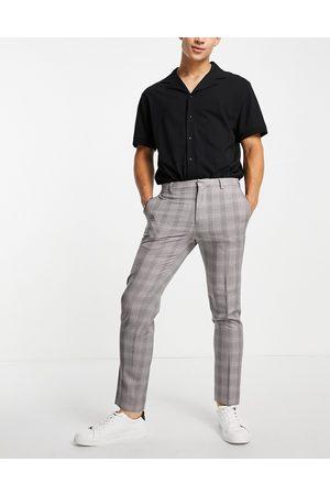 Burton Menswear Burton skinny fit burgundy check suit trousers in