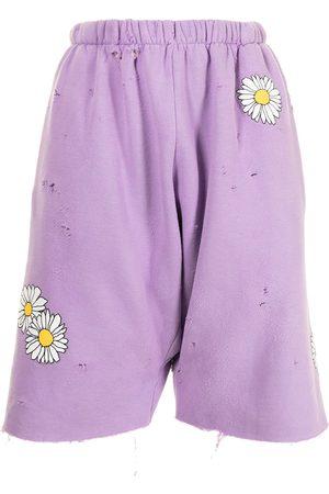 Natasha Zinko Daisy-print track shorts