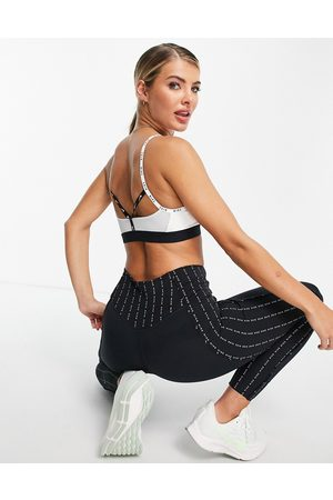 Nike Training Indy light support tapping sports bra in