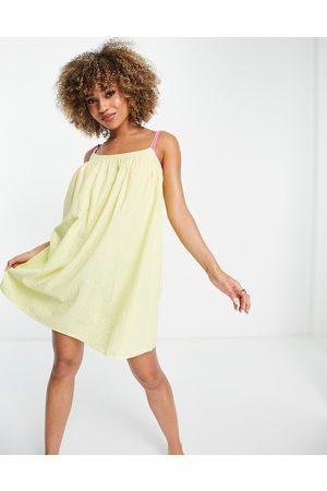 ASOS DESIGN Seersucker bow back beach mini dress in
