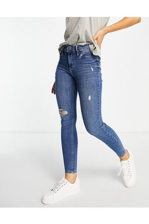 River Island Mid rise ripped skinny jeans in dark