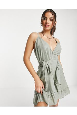 ASOS Tie wrap around mini sundress in self grid check in khaki