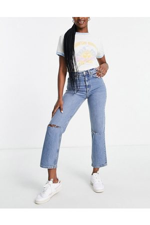 ASOS DESIGN High rise stretch 'slim' straight leg jeans in midwash with rips