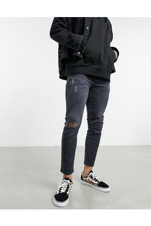 ASOS Men Skinny - Cropped skinny jeans in 'less thirsty' wash with rips