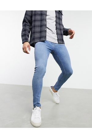ASOS Men Skinny - Spray on jeans in power stretch with 'less thirsty' wash
