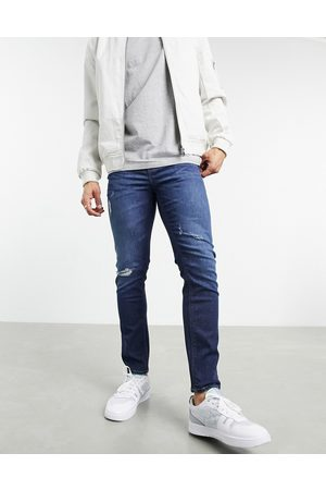 ASOS Men Skinny - Cropped skinny jeans in 'less thirsty' dark wash with rips