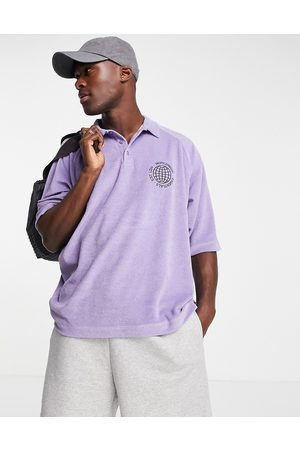 ASOS DESIGN Men Polo Shirts - Relaxed polo t-shirt in purple towelling with chest embroidery