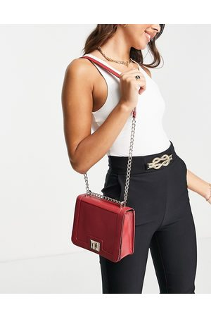 ASOS DESIGN Leather crossbody bag with hardware detail in