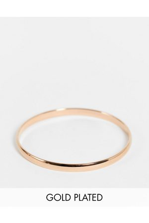 Kate Spade Stop And Smell Roses engraved bangle in rose plating