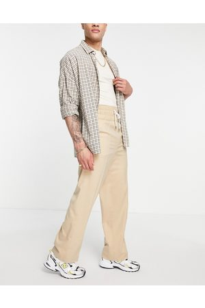 ASOS DESIGN Men Chinos - Wide leg smart trousers with elasticated waist band in stone cross hatch-Neutral