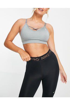 Nike Nike Yoga Indy light support cross strap sports bra in marl