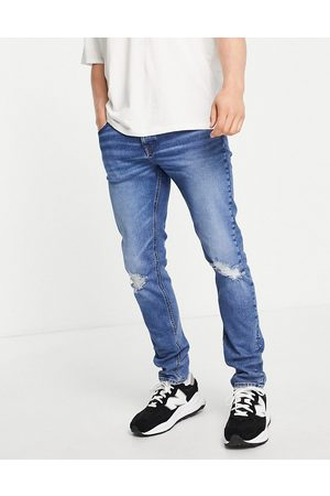 ASOS DESIGN Organic cotton blend skinny jeans in dark wash with knee rips