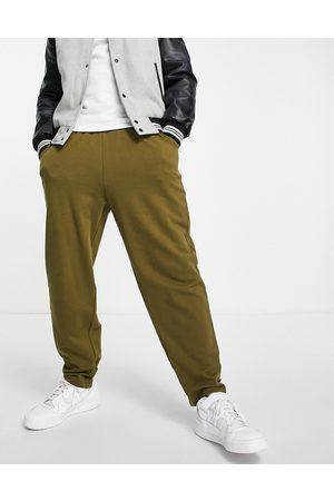 ASOS DESIGN Men Joggers - Organic oversized joggers with ankle strap in