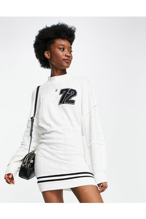 ASOS DESIGN Cable knit jumper dress with logo in ivory