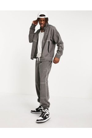 Nike Revival washed jersey track jacket in