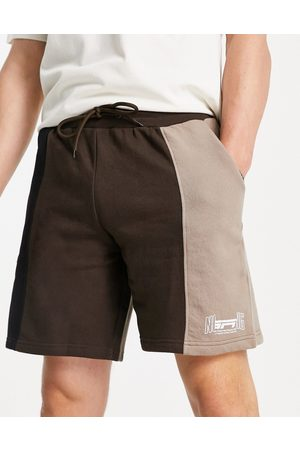 Good For Nothing Spliced jersey shorts in black and brown with mixed logo print-Multi