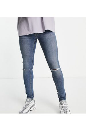 Collusion X001 super skinny jeans with knee rip in mid washed